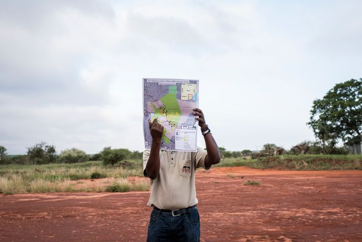 Ben Okita, head of research operations at Save the Elephants, points out where in the two ...