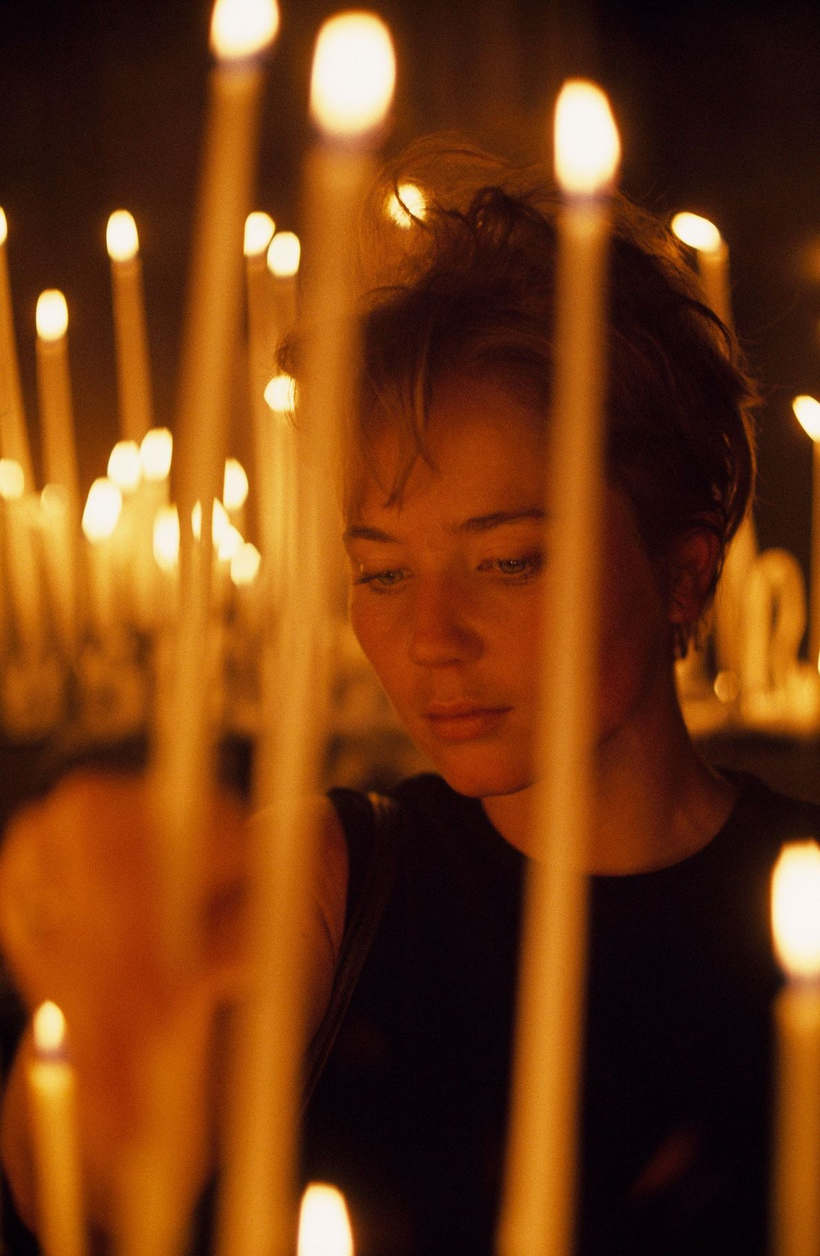 An American visitor lights a candle in the cathedral in 1968.