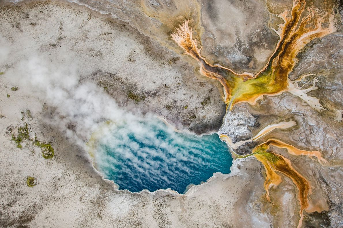Gentian Pool in Yellowstone National Park's Lower Geyser Basin is photographed from above.