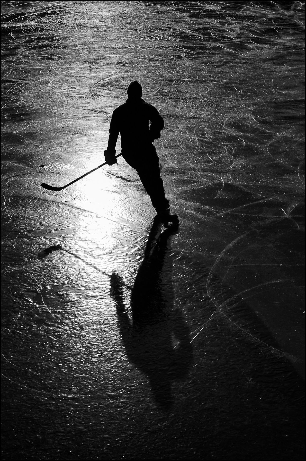 """""""A man warms up for a pick-up ice hockey game in Boston Public Gardens,"""" writes Your ..."""