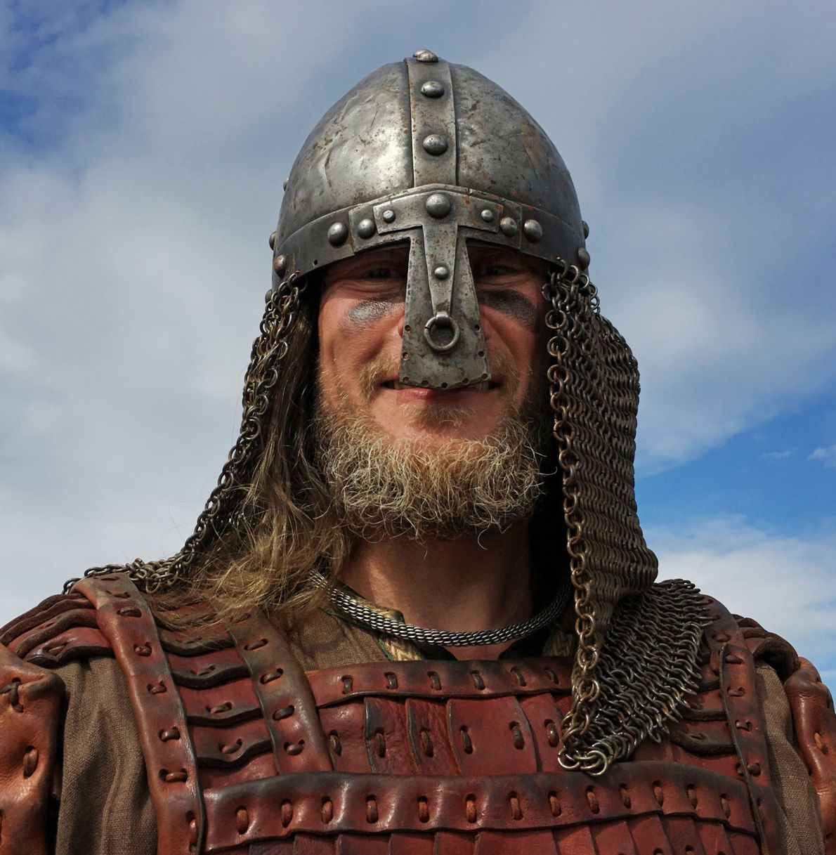 Concealed in iron helmets, chain mail, and leather cuirasses, Viking reenactors make a formidable impression, revealing ...