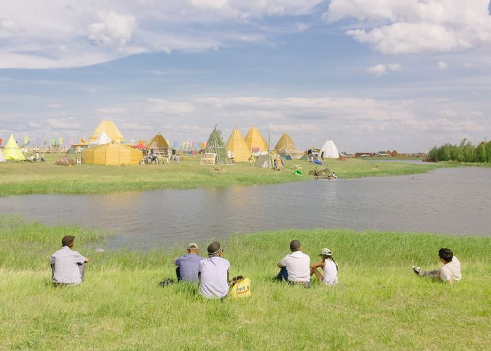 Locals relax by a lake at Us Khatyn, the alaas (ritual open space) of Yakutsk. Traditionally, ...
