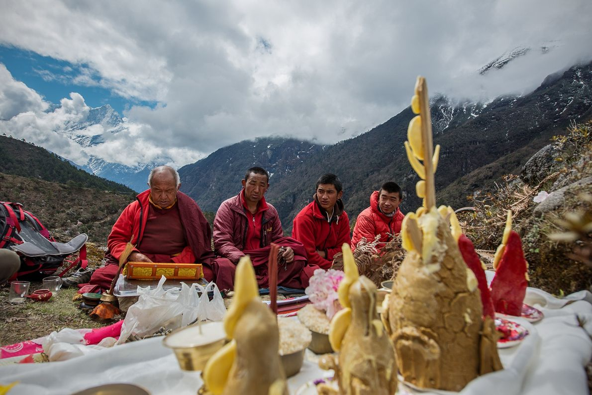 Elders perform a cremation ceremony for Pasang Diki Sherpa, a woman who died in her home ...
