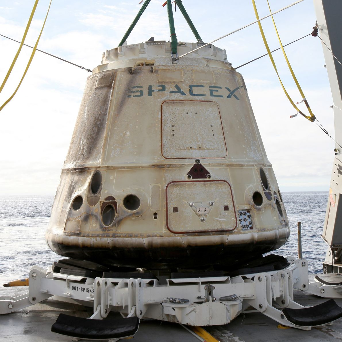 A Dragon cargo craft is recovered from the Pacific in 2017.