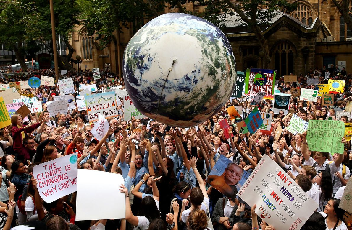 Protesters bounced an inflatable planet earth is bounced around the crowd during a Climate Change Awareness ...