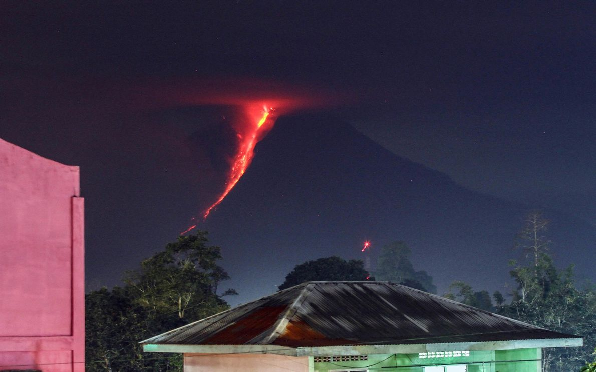 Lava streams down the flanks of Mount Sinabung in this 2018 image in Karo, North Sumatra. ...