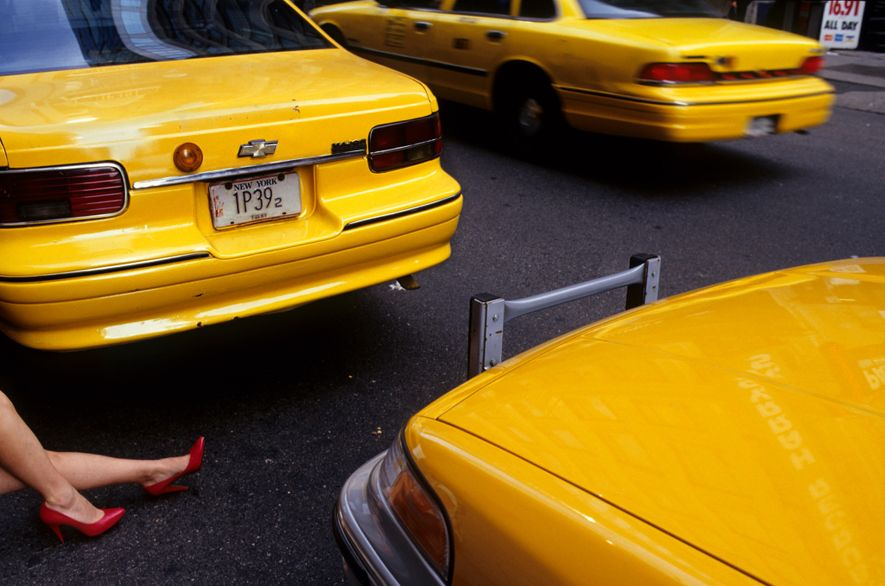 Leg, red high heels and taxis, Times Square.
