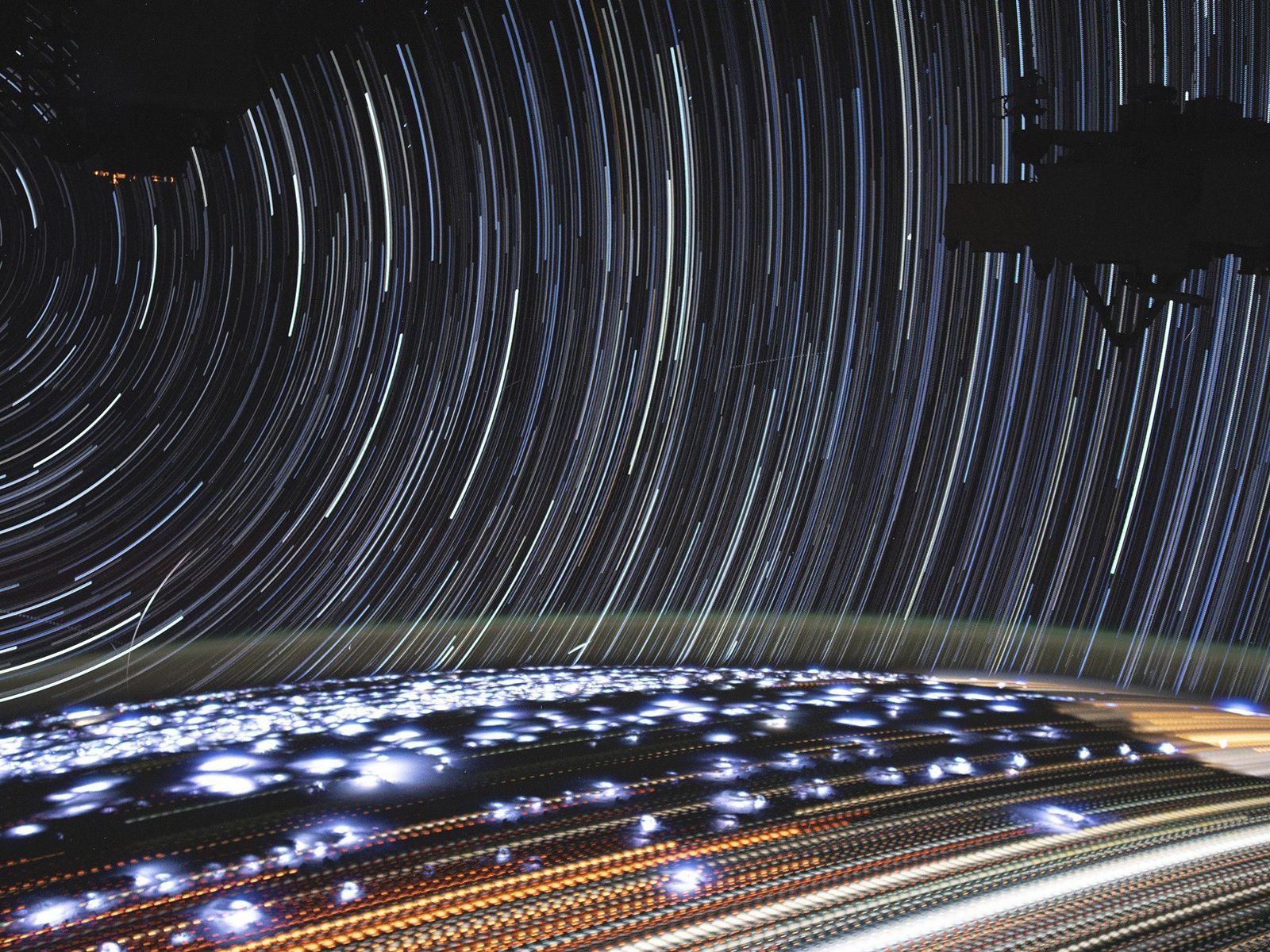 NASA astronaut Christina Koch compiled this stunning long-exposure picture of Earth against a backdrop of wheeling ...