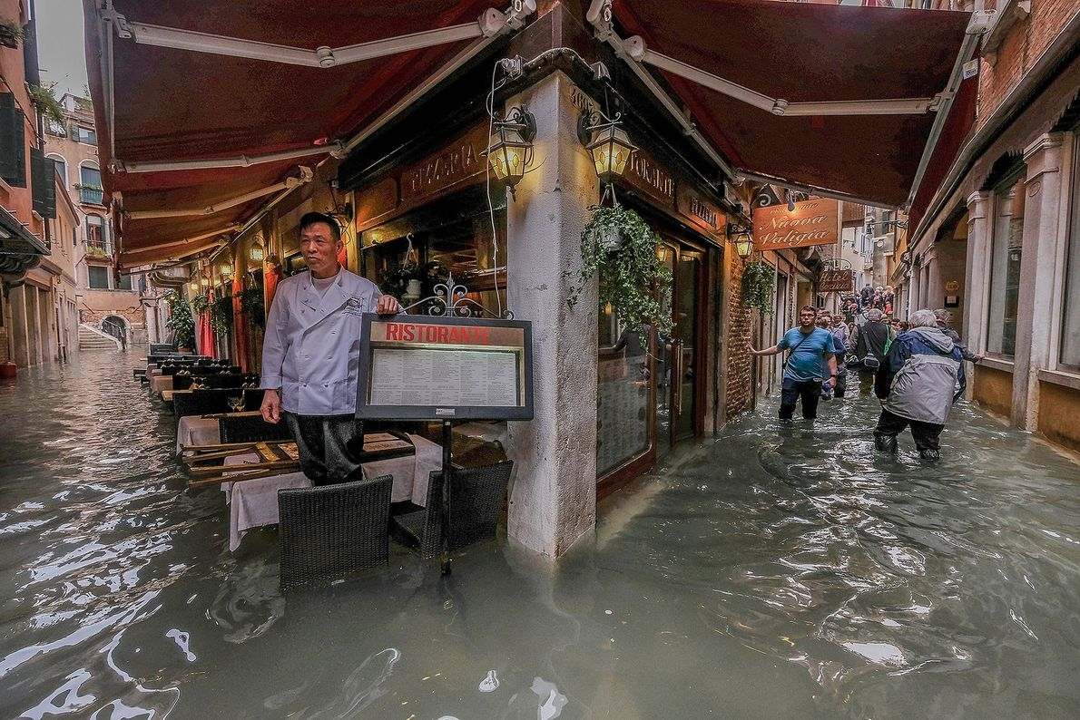 A restaurant owner surveys the high water.