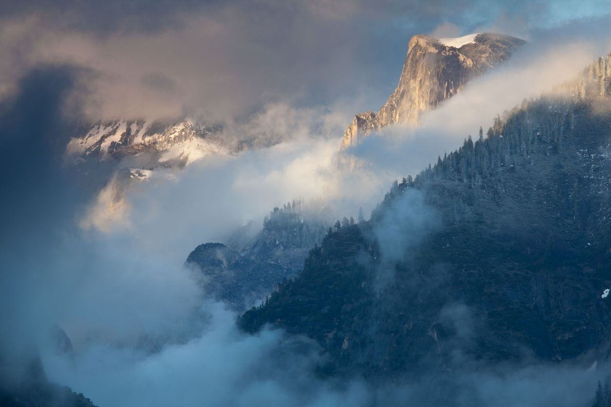 This 2010 photo shows Half Dome poking through the clouds. Hikers should not to attempt the ...