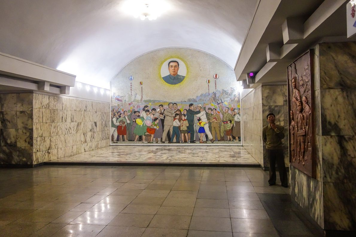 A mural in Tongil Station depicts the nation's dream of the future. Kim Il Sung, the ...