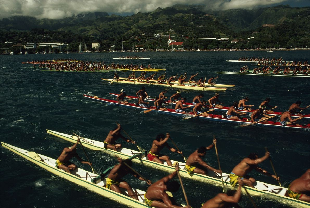 Teams compete in the annual outrigger rowing competition in Papeete Harbor, Tahiti.