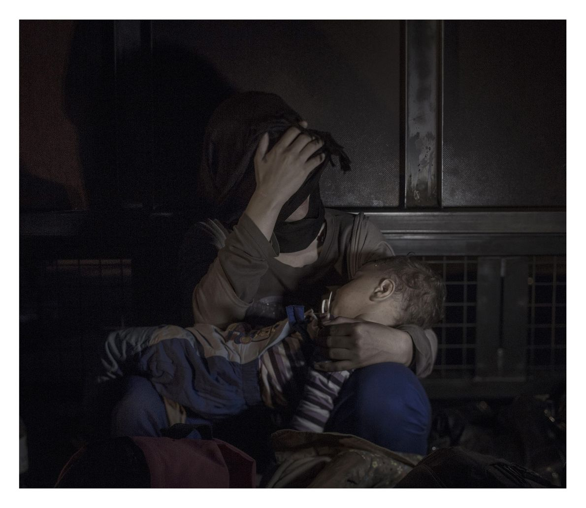 One-year-old Sham is cradled by his mother, only inches from the closed Hungarian border. The day ...