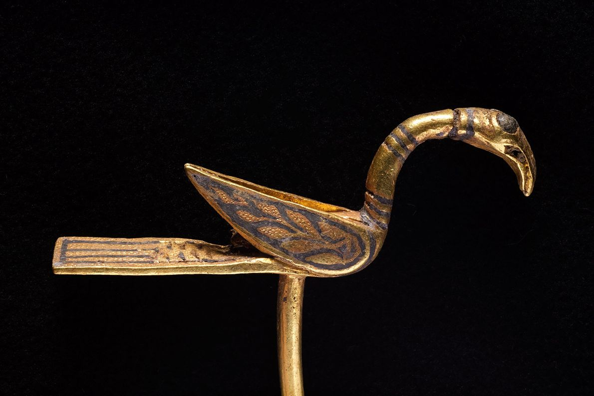 Made of gold, this bird-shaped object may have been a decorative pin or a manuscript pointer ...