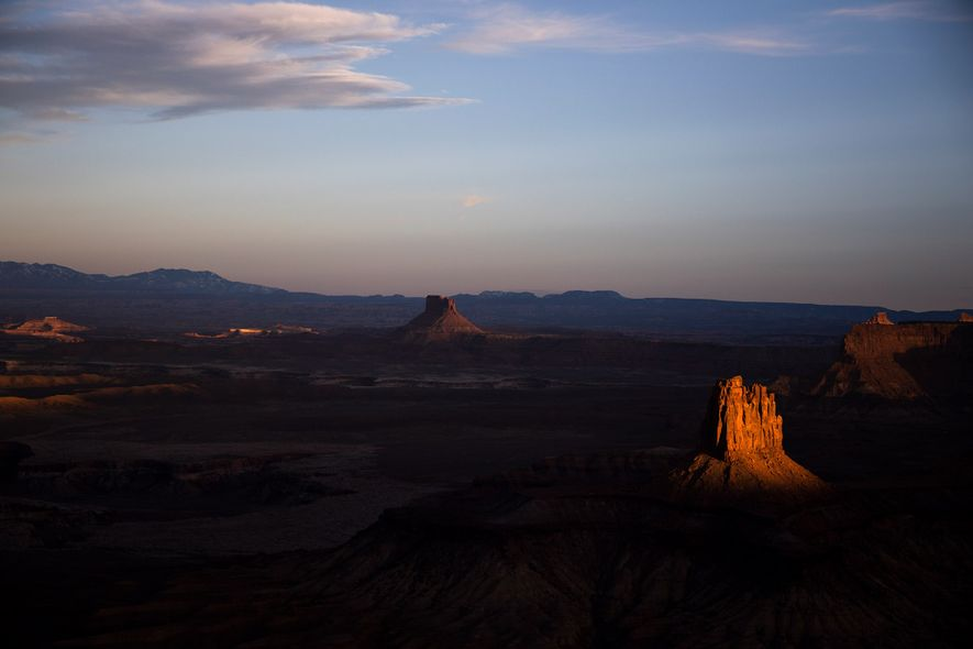 Sandstone buttes radiate sunset light in the desert surrounding Moab, Utah, just south of the Colorado ...
