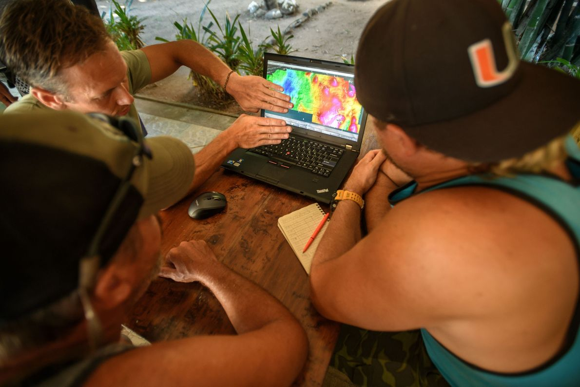 Archaeologists review a map of anomalies detected during an underwater magnetometer survey near Villa Rica de ...