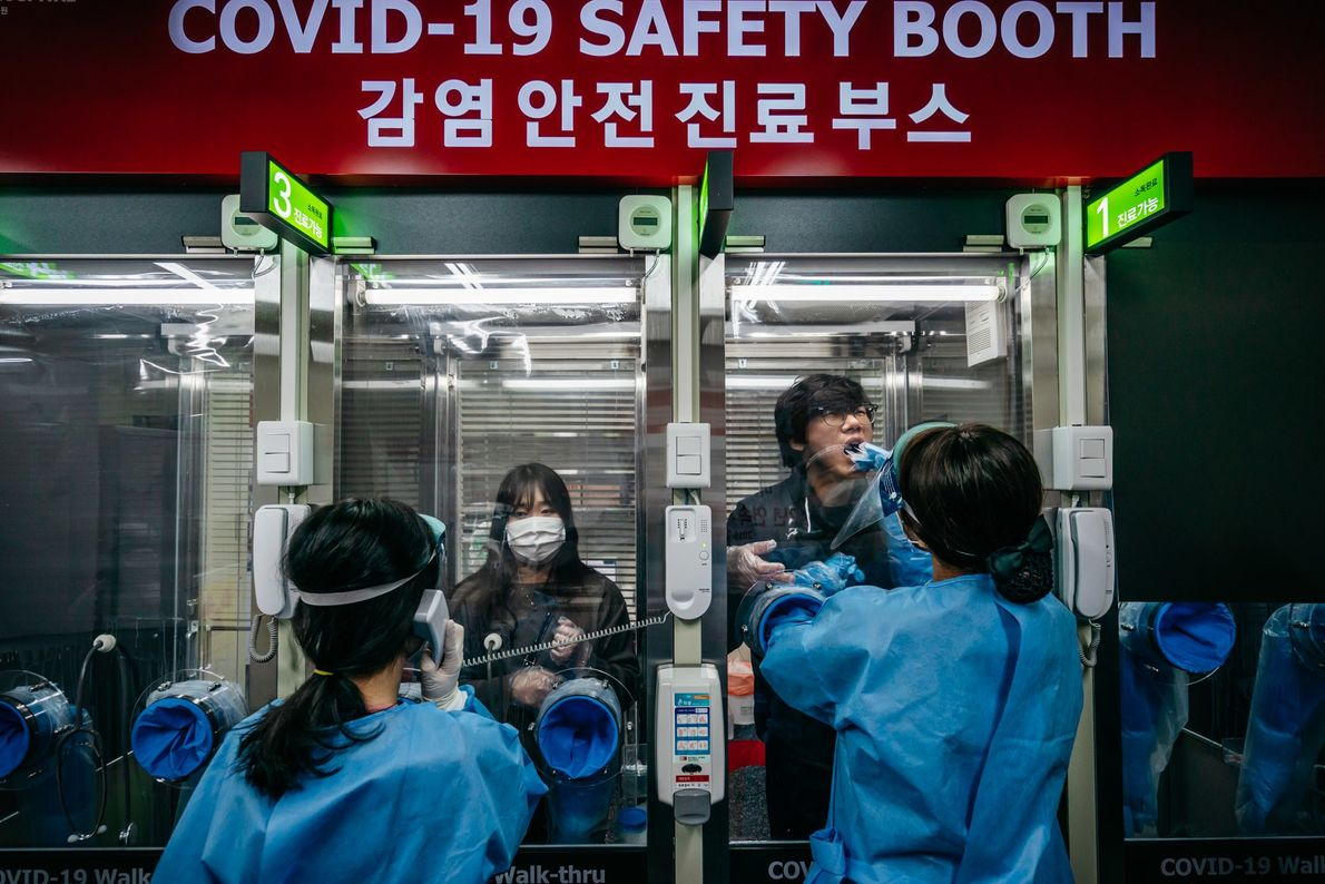 Walk-in patients get tested for COVID-19 at a private hospital in Seoul, South Korea. Testing areas ...