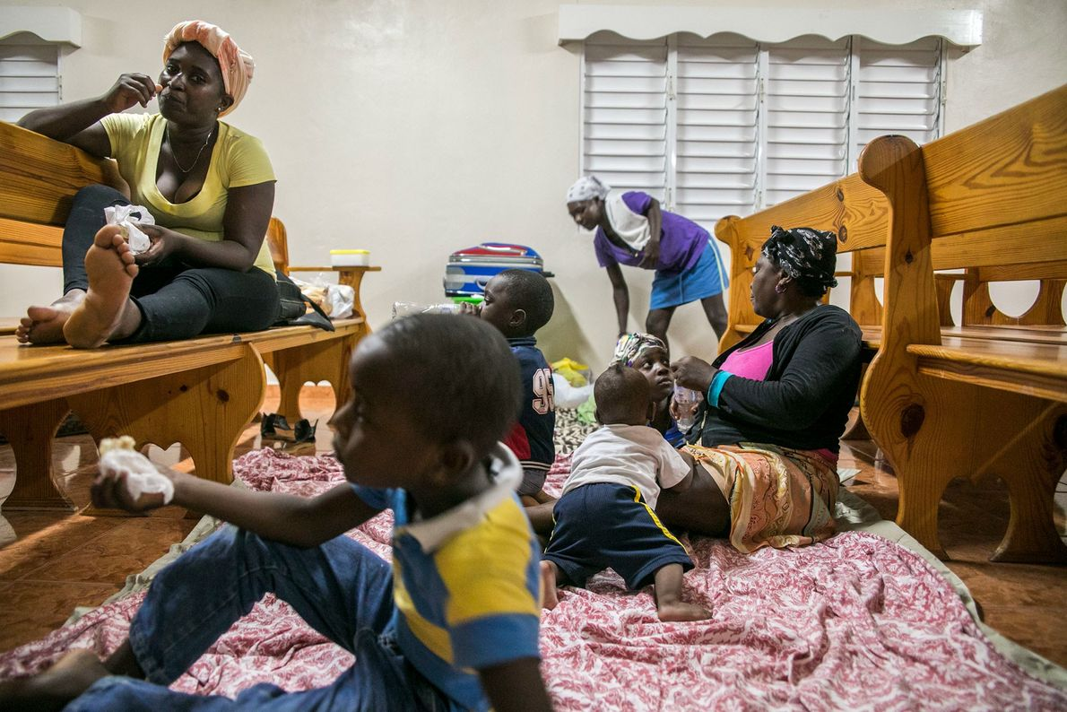 Families gather at a shelter in a local church the evening before Irma struck Las Terrenas, ...