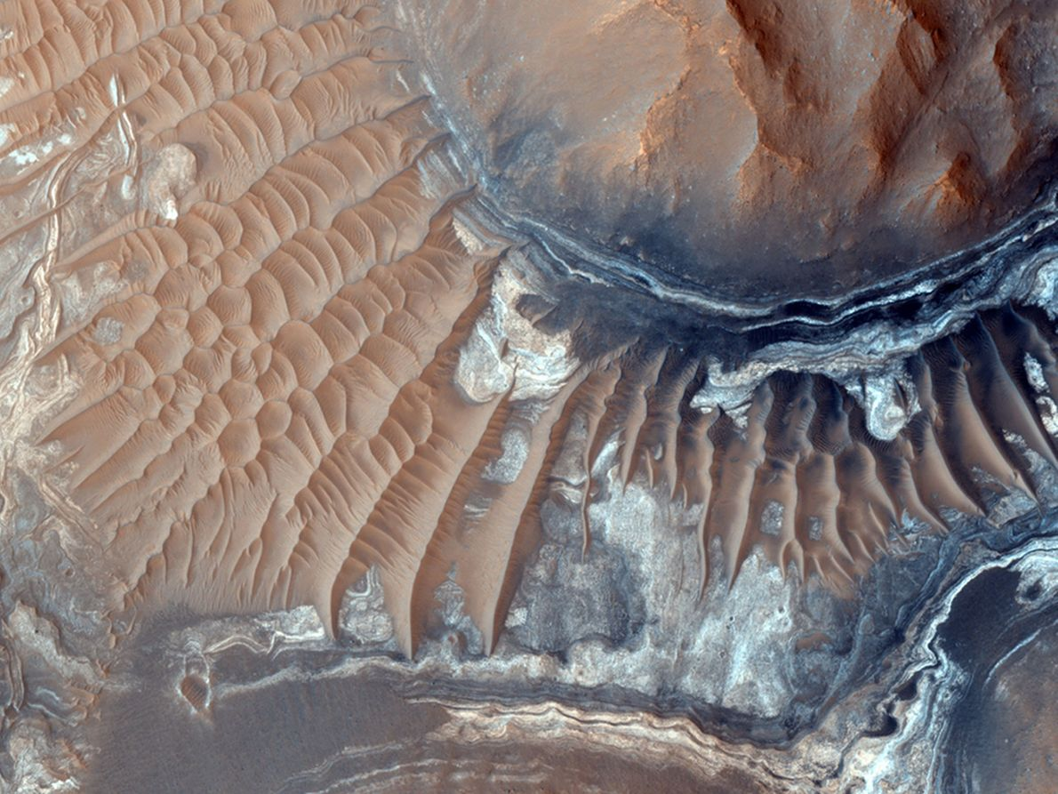 Sand dunes litter the floor of Aram Chaos, an eroded impact crater east of Mars' Valles ...