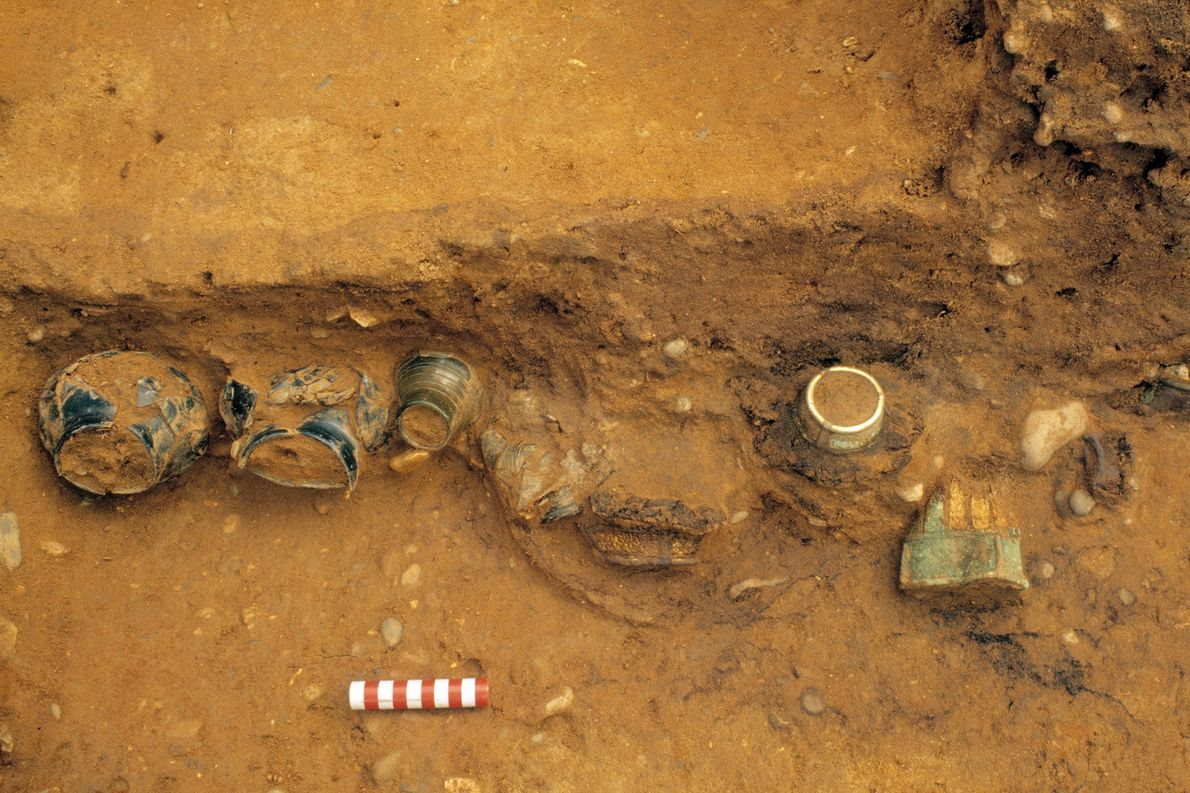 Drinking vessels emerge from the chamber during the 2003 excavation.