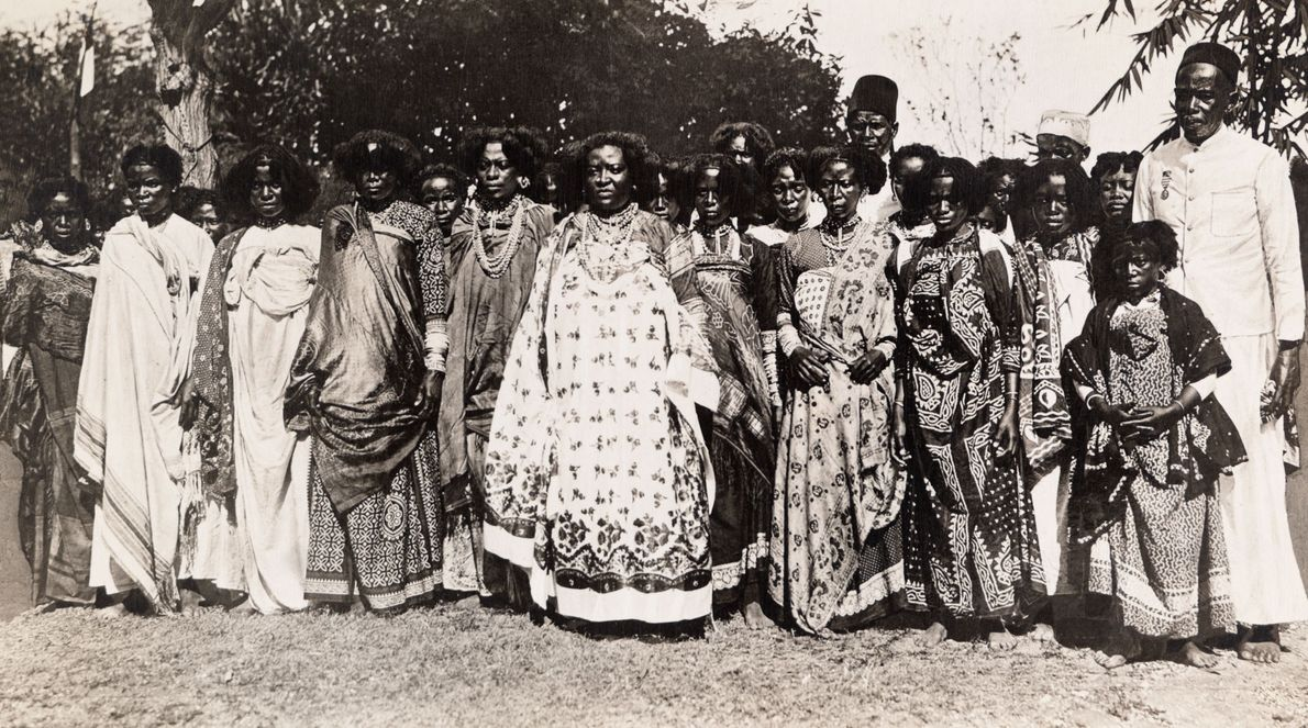 Queen Binao of Madagascar stands in front of her court in 1913. She was later stripped ...