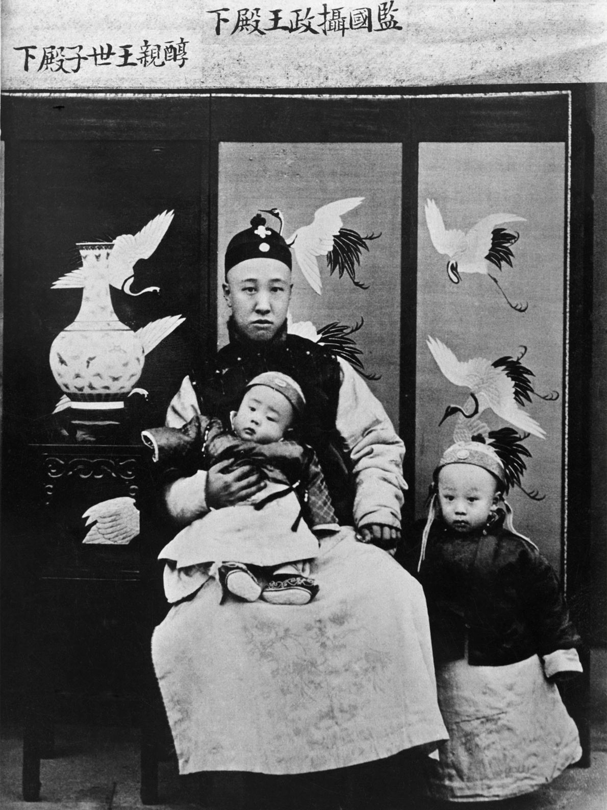 Prince Chun, a regent of China, holds his son, Emperor Hsuan Tung, in the Liaoning Province. ...
