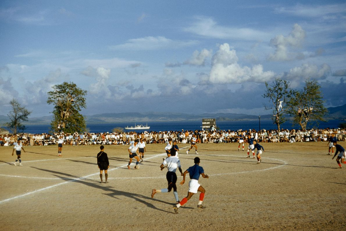 In 1959, rival footbal teams from Martinique and Guadalupe play a match in Fort de France, ...