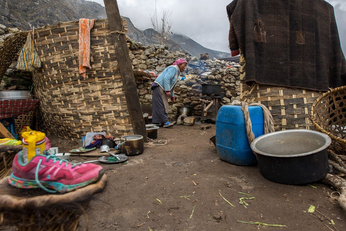 "After her home was destroyed, Kami Tshering Sherpa set up a makeshift kitchen. ""The people aren't ..."
