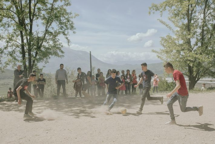 A soccer tournament at the school in Kuta. If a dam is built in Pocem, the ...