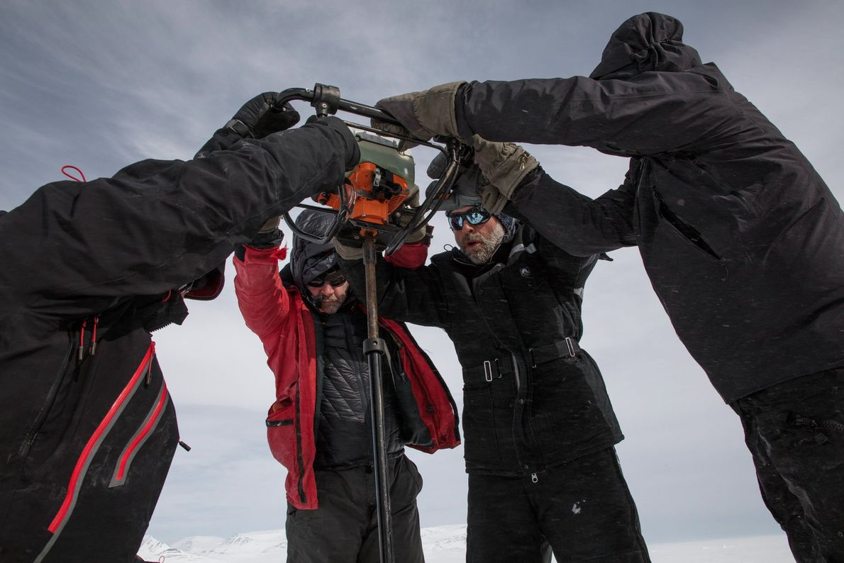 The sea ice is often thick and difficult to penetrate. Here, a team cuts a 2-square-metre ...