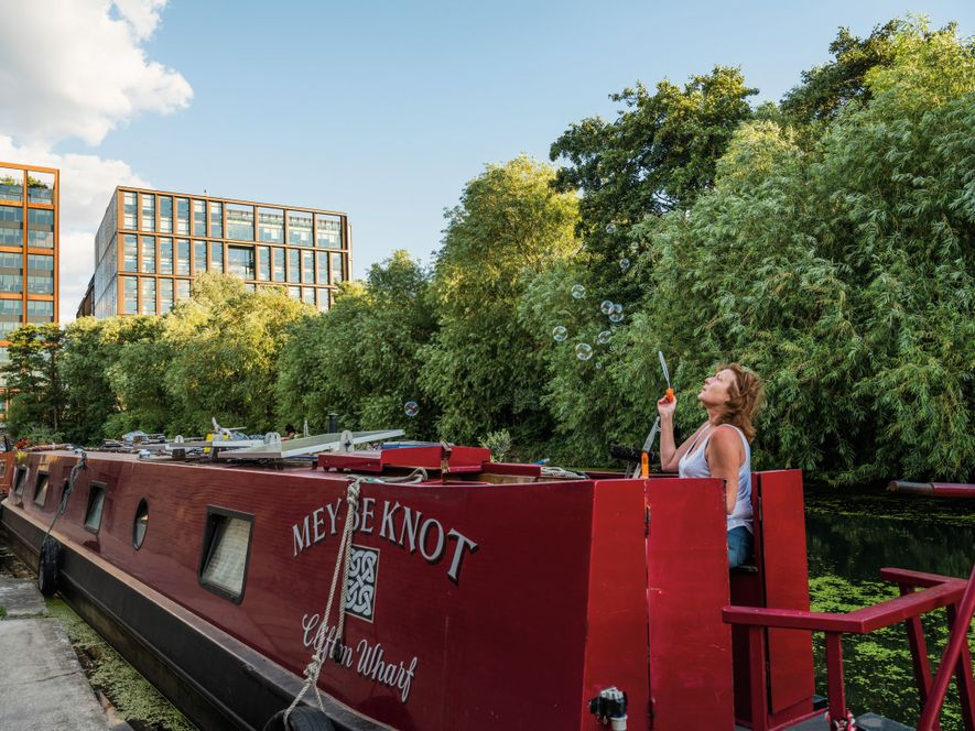 With the city's 100-mile network of canals—Regent's Canal in King's Cross seen here—houseboats became a response ...