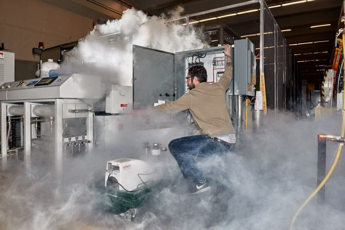 Nick Force, research engineer, doing routine maintenance with liquid nitrogen.