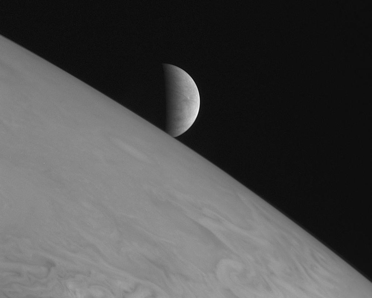 New Horizons took this image of Jupiter's icy moon Europa rising above the giant planet's cloud ...