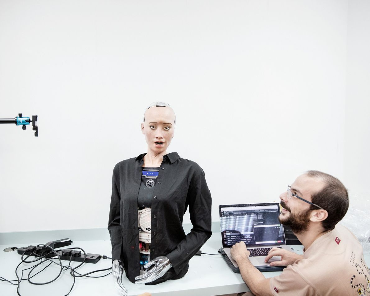 A sound engineer at Hanson Robotics works with Sophia. The robot has been able to give ...