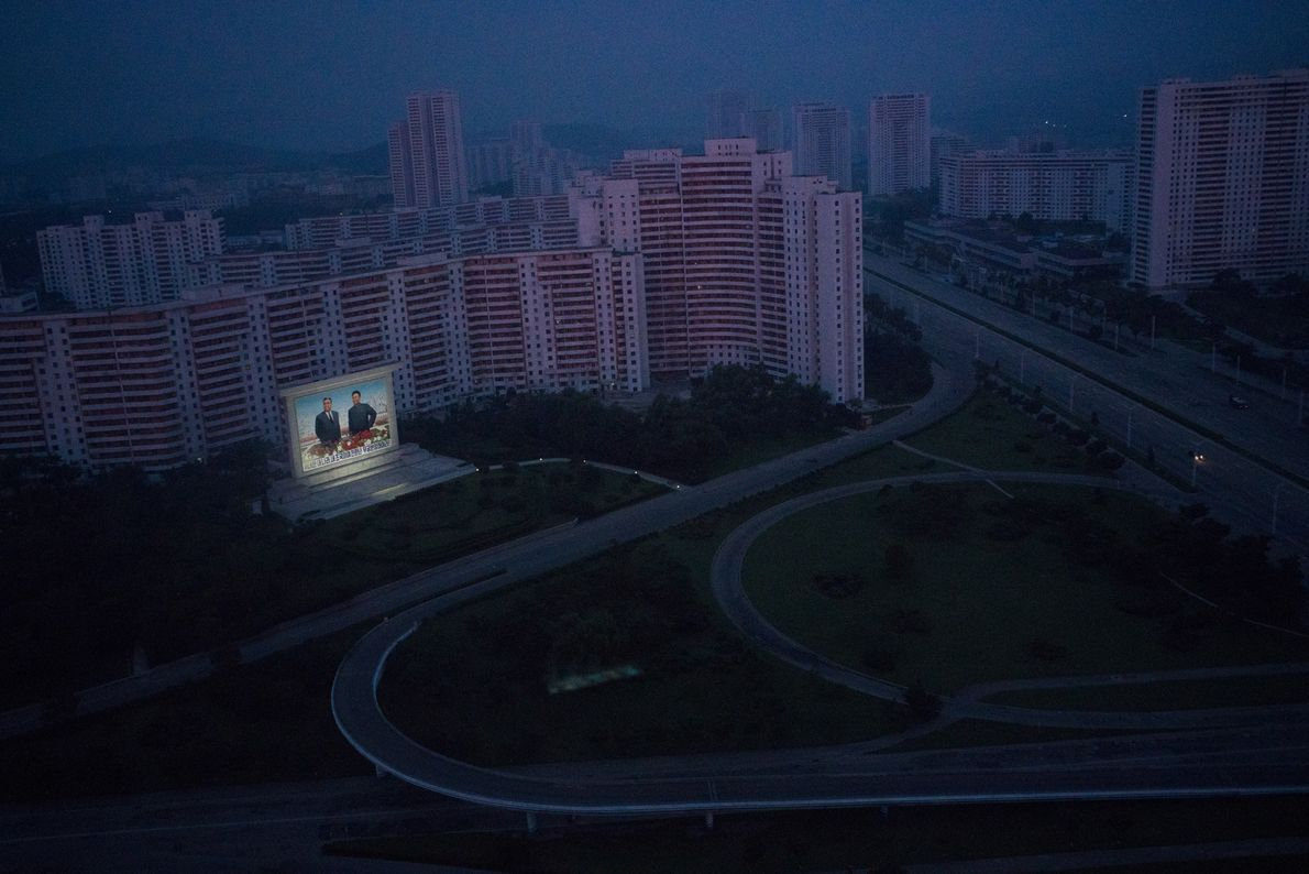 A monument to the late leaders Kim Il Sung and Kim Jong Il illuminated in Pyongyang.