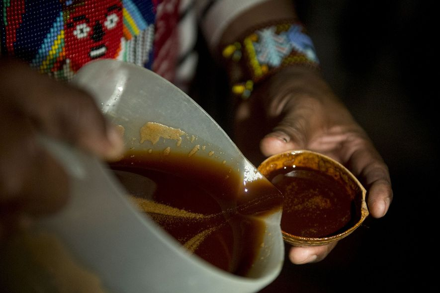 A healer offers ayahuasca during a ritual healing ceremony in Colombia. The Bolivian cave discovery is ...
