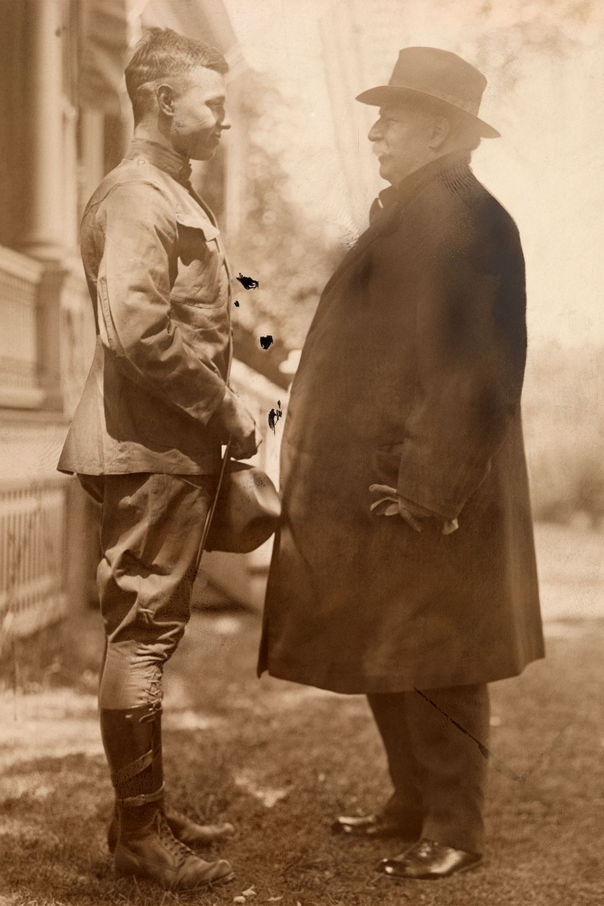 Former US President William Howard Taft stands with his son, who enlisted in the U.S. Army, ...