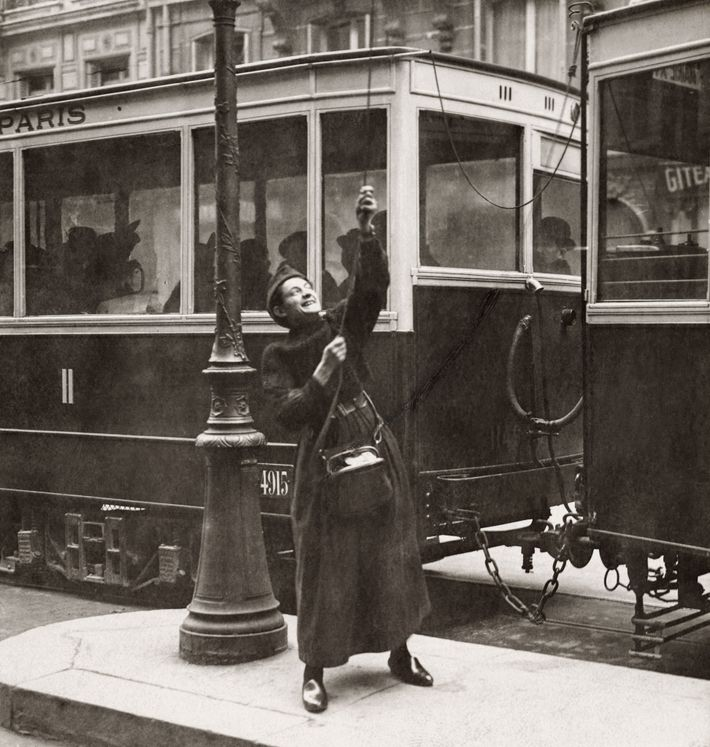 A woman working for the war effort helps operate a street car in Lorraine, France.