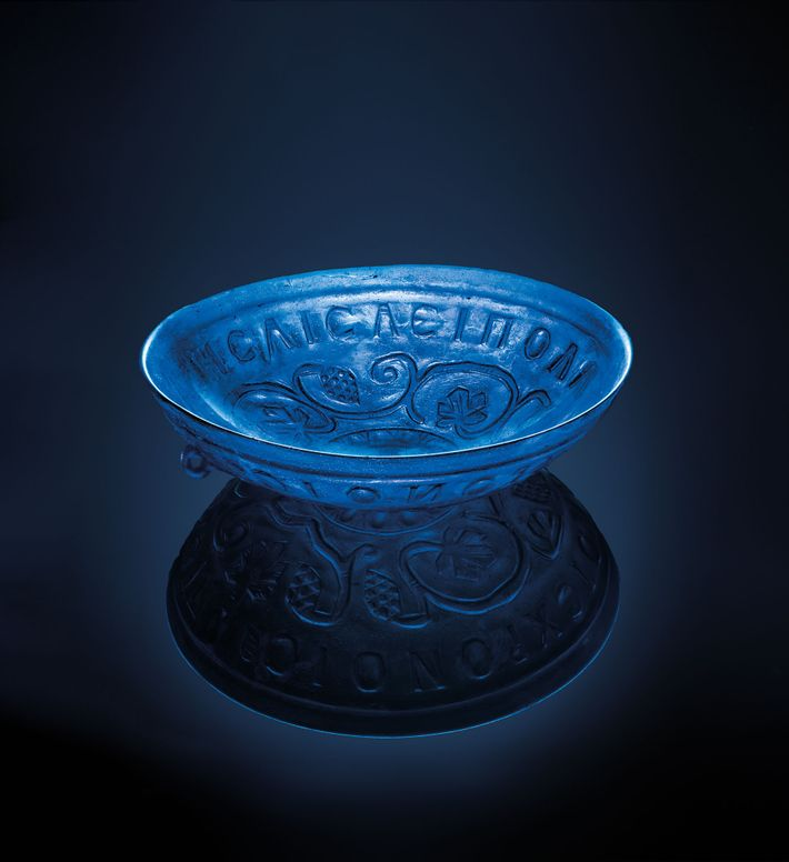 This 1,600-year-old transparent blue glass bowl, a little more than eight inches in diameter, was found ...