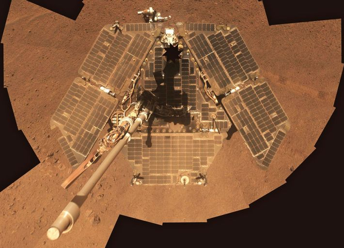 In March 2014, Opportunity took this self-portrait. Seasonal winds periodically cleaned dust off the rover's solar ...