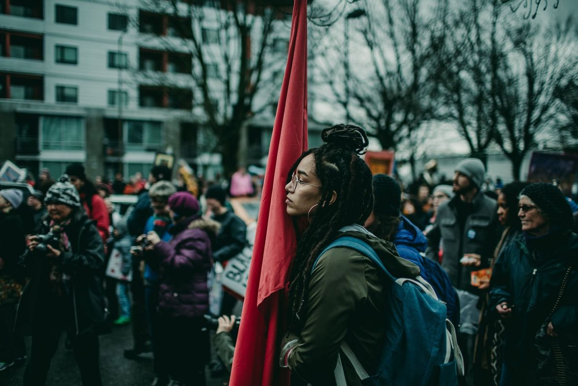 """""""Listening and gleaning knowledge from a speaker at the Reclaim MLK March for Human Rights and ..."""