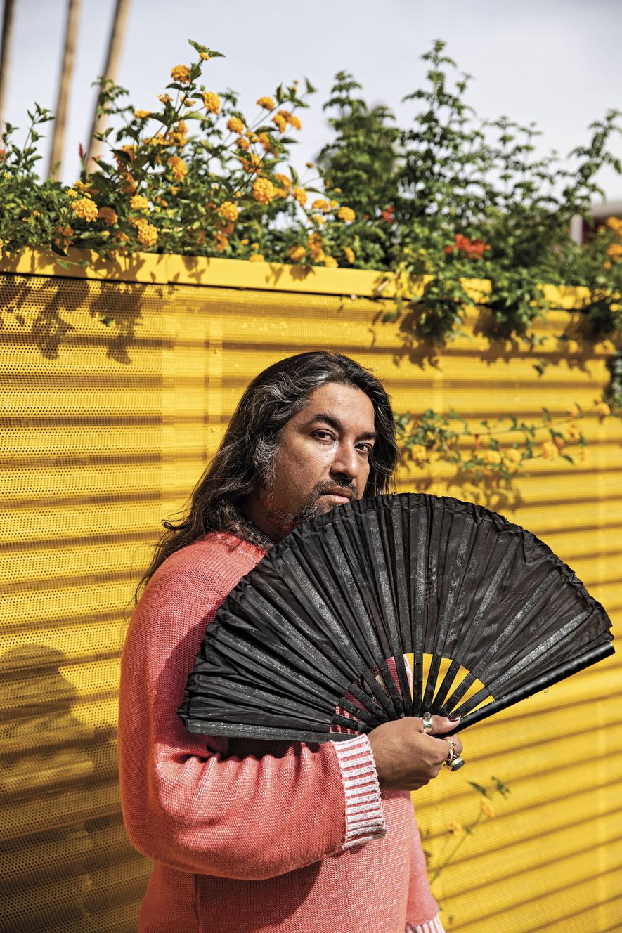 Jorge Castellon, an employee at the Saguaro Hotel in Palm Springs, California, displays the fans he ...