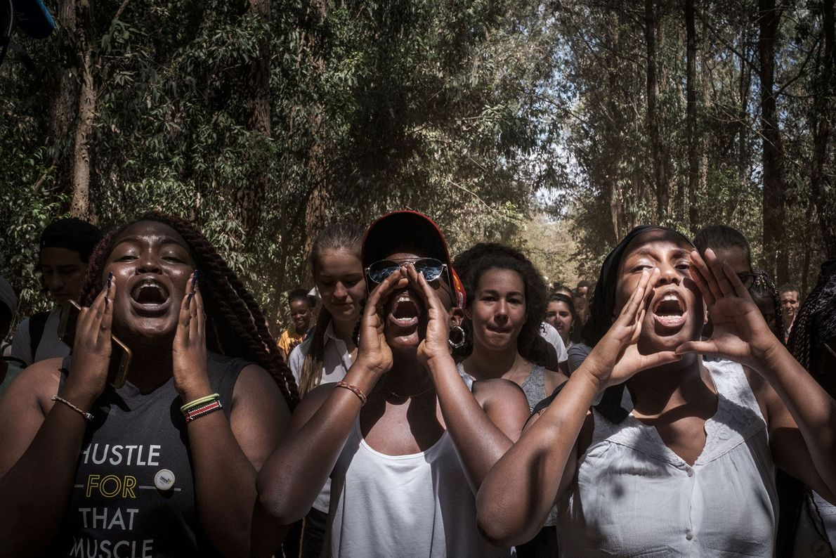 Students from the Braeburn Garden Estate School chant during a march in Nairobi, Kenya.