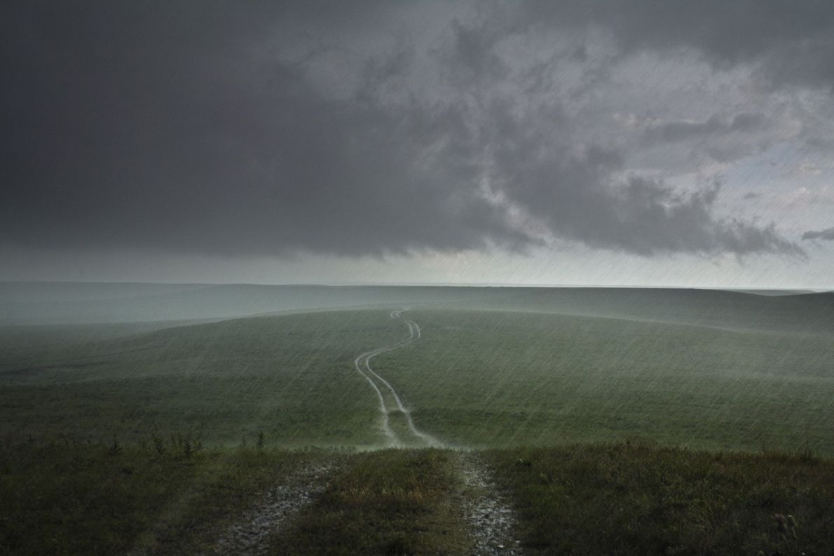 A heavy thunderstorm hits the Flint Hills in Strong City, Kansas. Kansas is one of several ...