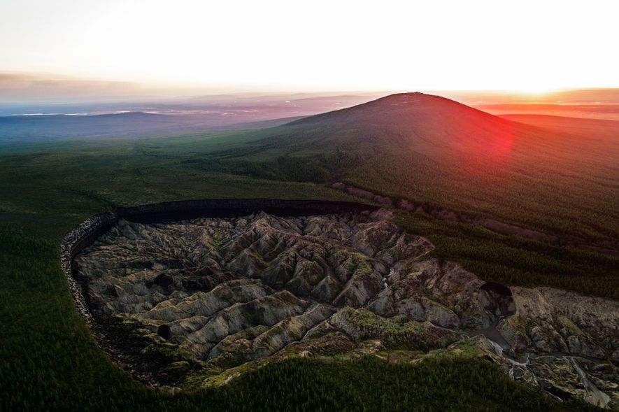 "The Batagaika Crater in the town of Batagay, Russia, is known as the ""hell crater"" or the ""gateway to the underworld."" Over 300 feet deep and more than half a mile long, the depression is one of the largest in the world. Scientists believe it started forming in the 1960s when the permafrost under the area began to thaw after nearby forests were cleared."