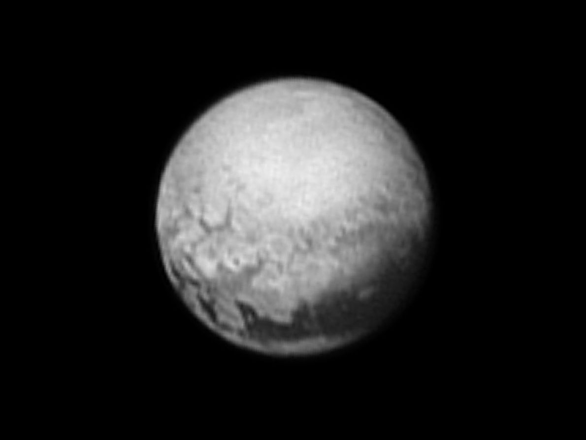Taken on July 9, 2015, this black-and-white view of Pluto shows the tail of an immense ...