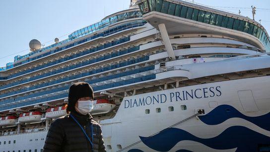 The Diamond Princess cruise ship (shown docked in Yokohama, Japan, on February 10) was quarantined in ...