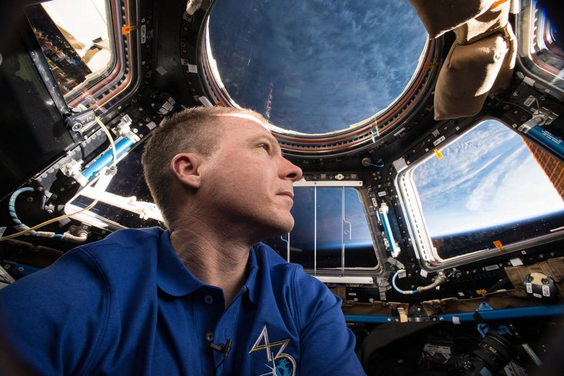 Expedition 43 commander and NASA astronaut Terry Virts is seen here inside  the station's Cupola ...