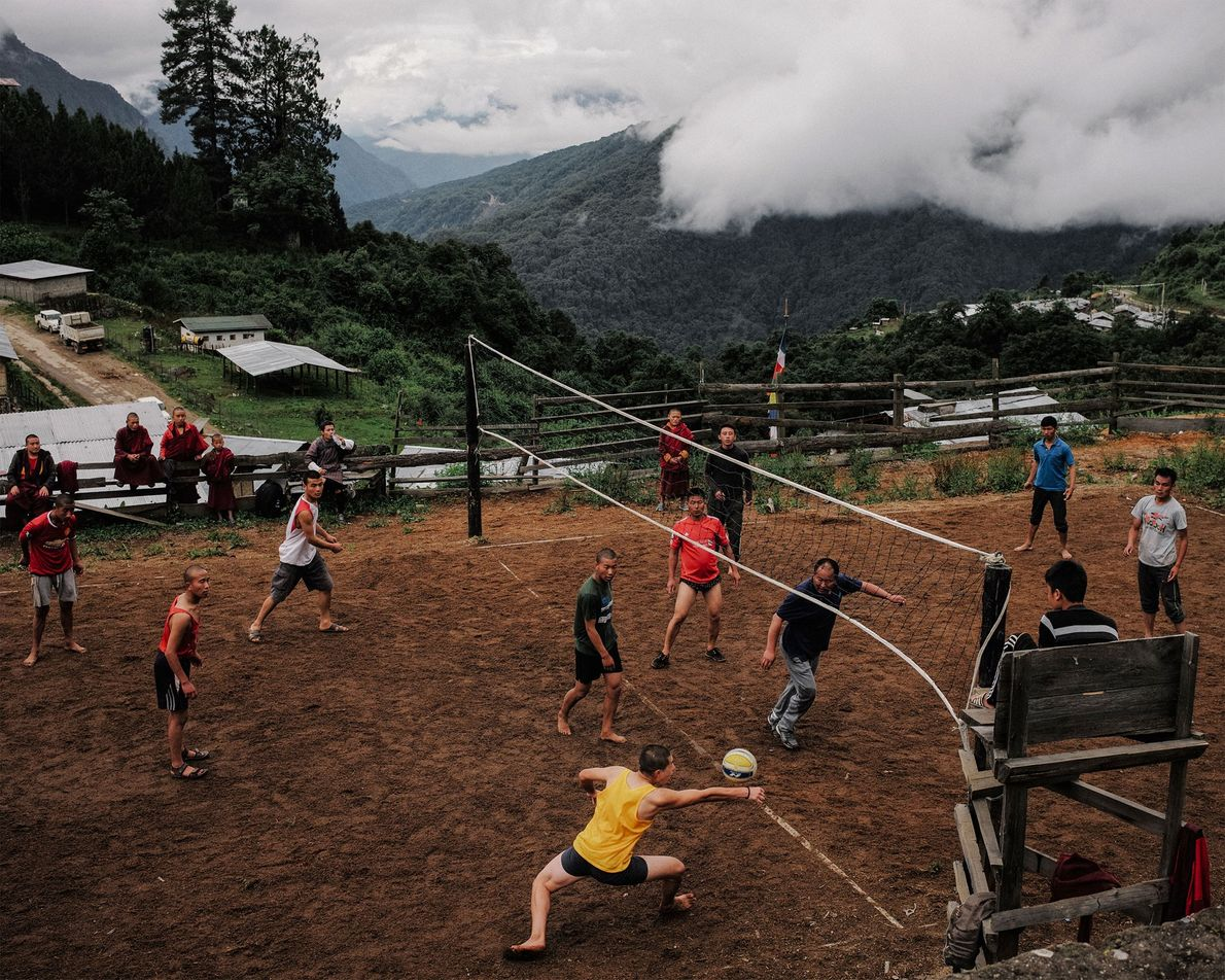 In Gasa, Bhutan, monks play a volleyball match against the local police. This photo originally published ...