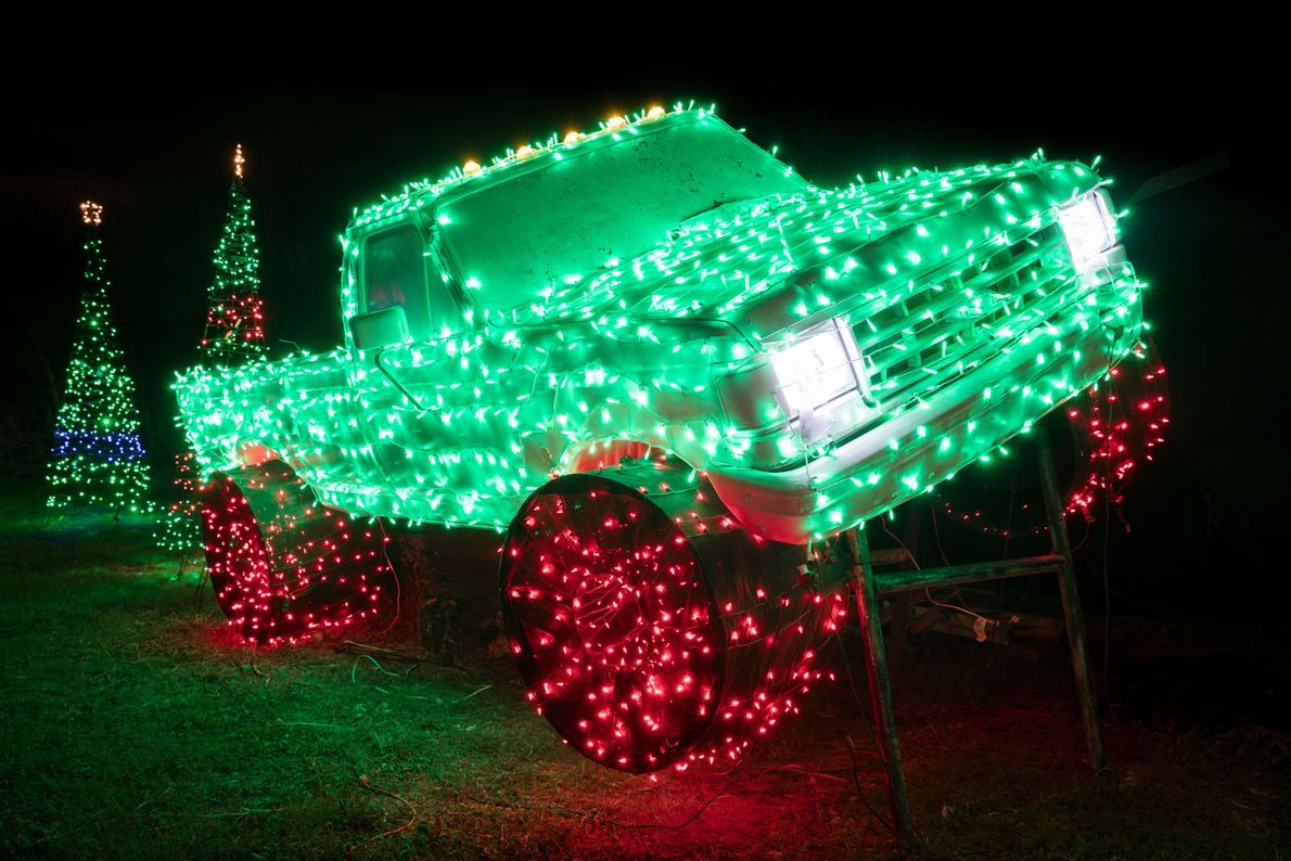 A holiday themed Ford Pickup truck at the Santa Ranch in New Braunfels almost seems like ...